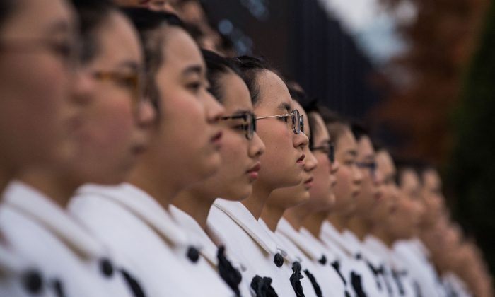 Chinese middle school girls in a choir performance. (Chandan Khanna/AFP/Getty Images)