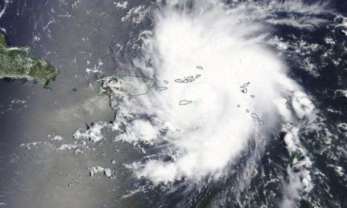 Hurricane Dorian is shown in this photo taken by NASA's Terra satellite MODIS instrument as it nears St. Thomas and the U.S. Virgin Islands as it continues its track toward Florida's east coast August 28, 2019. NASA Worldview, Earth Observing System Data and Information System (EOSDIS)/Handout via REUTERS