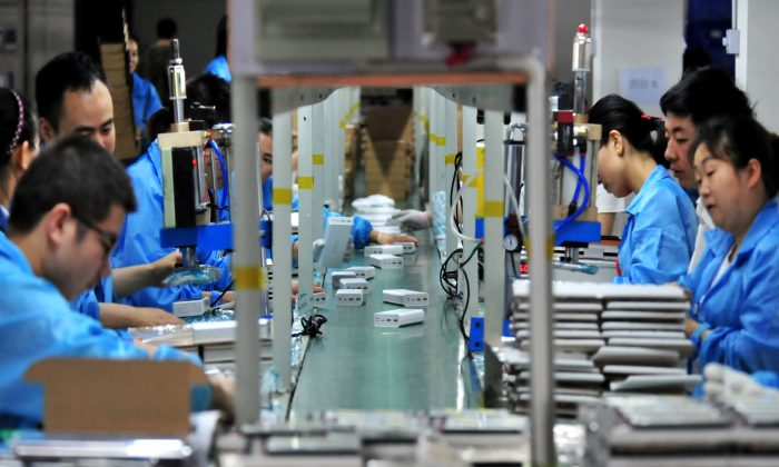 Employees work on a production line manufacturing lithium battery products at a factory in Yichang, Hubei Province, China on May 28, 2019. (Reuters)