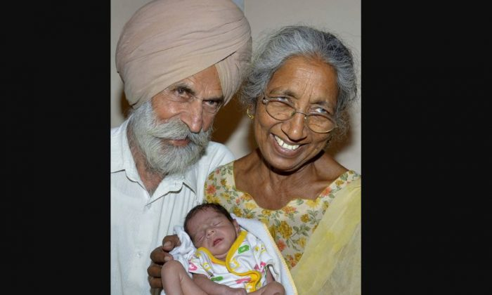 Daljinder Kaur and her husband, Mohinder Singh Gill, pose for a photograph with their newborn baby boy Arman at their home in Amritsar, India, on May 11, 2016. Kaur was was over 70 when she gave birth in April after two years of IVF treatment at a fertility clinic. (NARINDER NANU/AFP/GETTY IMAGES)