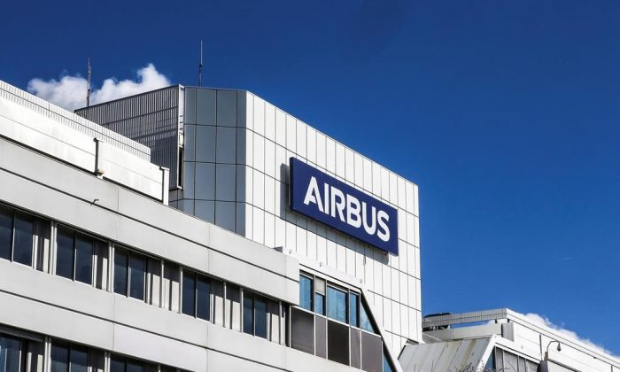 This March 6, 2018, photo shows a logo of Airbus group is displayed in front of its headquarters in Toulouse, western France. European aerospace giant Airbus is pulling out of the high-stakes competition to build Canada's next fighter jet following complaints about the competition. (Fred Scheiber/AP/The Canadian Press)