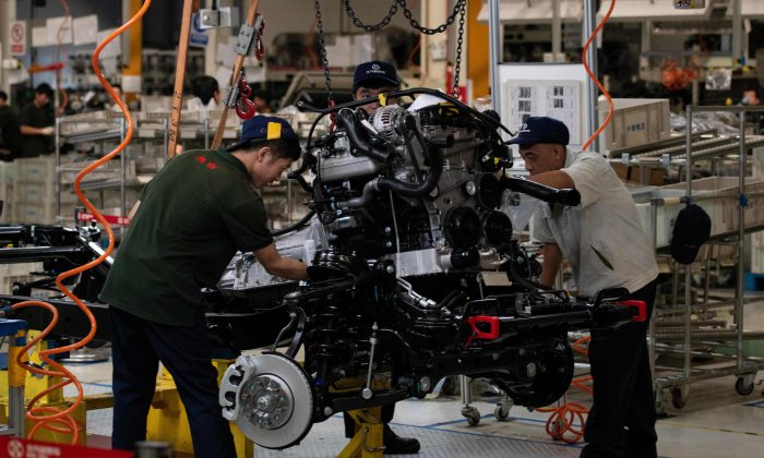 Workers on an SUV production line on the BAIC (Beijing Automotive Group Co.) in Beijing on Aug. 29, 2018. (NICOLAS ASFOURI/AFP/Getty Images)
