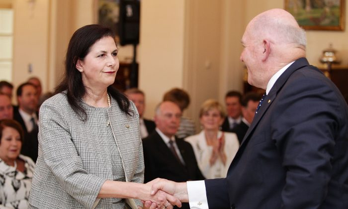 Concetta Fierravanti-Wells is congratulated by Governor-General Sir Peter Cosgrove in Canberra, Australia on Sept. 21, 2015. (Stefan Postles - Pool/Getty Images)