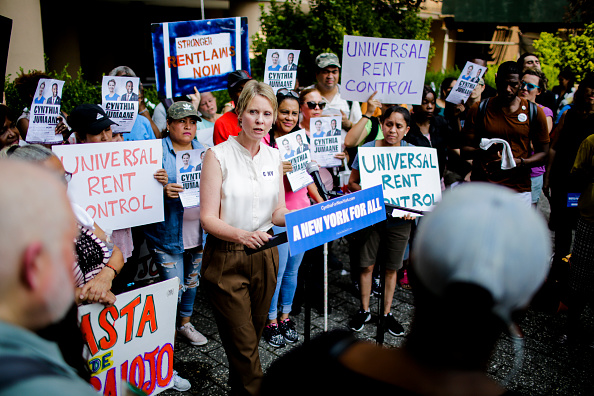 Democratic gubernatorial candidate Cynthia Nixon speaks to attendees during a rally for universal rent control on August 16, 2018 in New York City. Cynthia Nixon, who is running against Gov. Andrew M. Cuomo for the governor seat has pushed for a more response to high rents, also, Nixon has said that cities throughout the state should be allowed to impose it. Only NYC and some nearby areas are allowed to impose rent control, and only on apartments built before 1974. (Photo by Eduardo Munoz Alvarez/Getty Images)