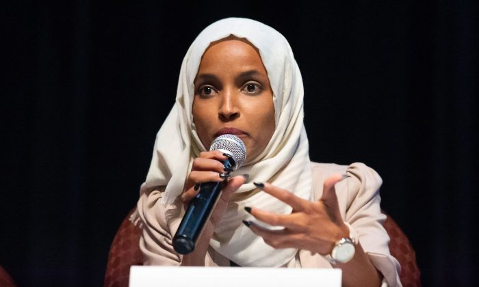 Rep. Ilhan Omar (D-Minn.) speaks on stage during a town hall meeting at Sabathani Community in Minneapolis, Minnesota on July 18, 2019. (Photo by Kerem Yucel /AFP/Getty Images)