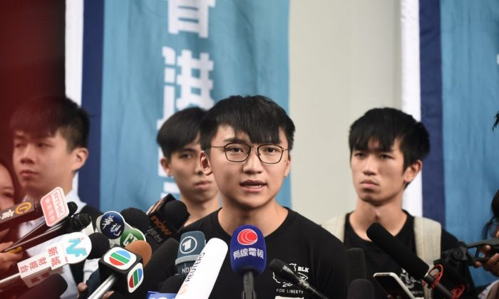 Demosisto vice-chairperson Isaac Cheng speaks to press on the arrest of Joshua Wong and Agnes Chow, in Hong Kong on Aug. 30, 2019. (Lillian Suwanrumpha/AFP/Getty Images)