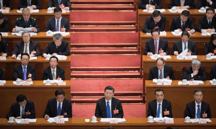 Chinese leader Xi Jinping (front C) attends the fourth plenary session of the Chinese Communist Party's rubber-stamp legislature, the National People's Congress, at the Great Hall of the People in Beijing on March 13, 2018. (NICOLAS ASFOURI/AFP/Getty Images)