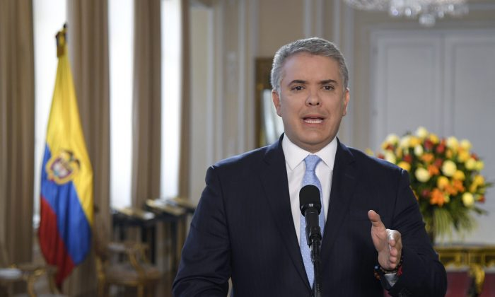 President Ivan Duque gives a statement at Palacio de Narino in Bogota, Colombia, Thursday, Aug. 29, 2019. (Efrain Herrera/Colombia's Presidential Press Office via AP)
