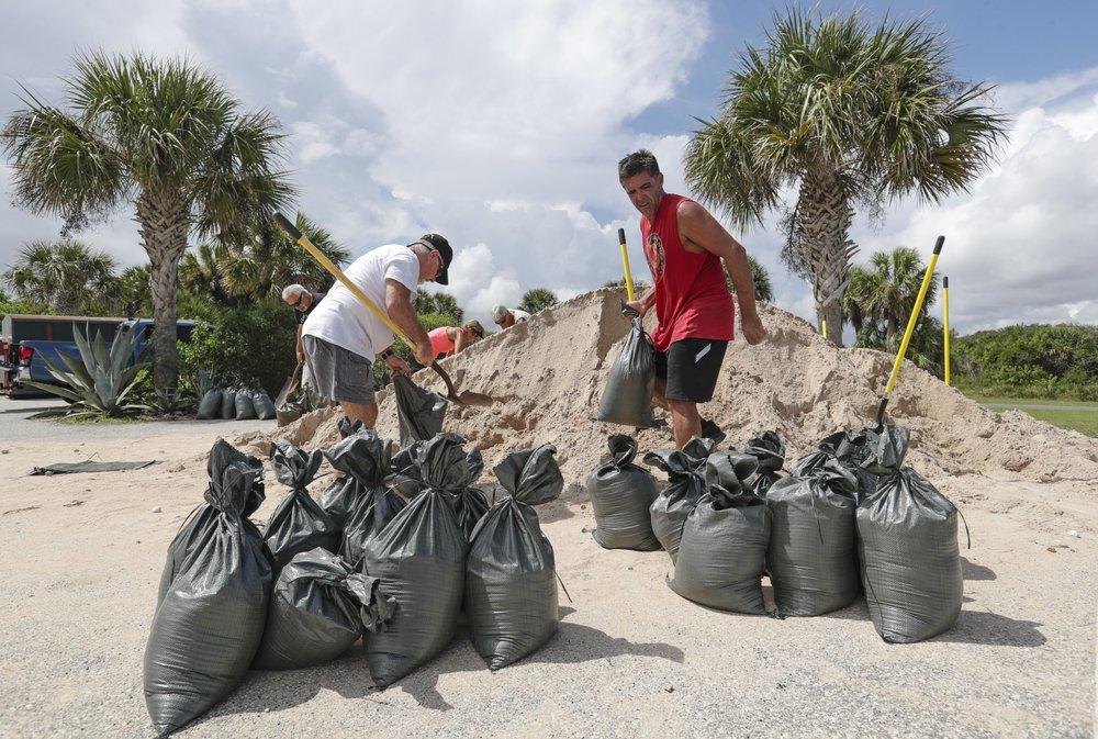 Residents of Flagler Beach, Fla., fill sandbags