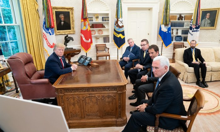 President Donald J. Trump, joined by Vice President Mike Pence, receives a briefing on Hurricane Dorian as it approaches the U.S. mainland in the Oval Office of the White House on Aug. 29, 2019. (Official White House Photo by Shealah Craighead)