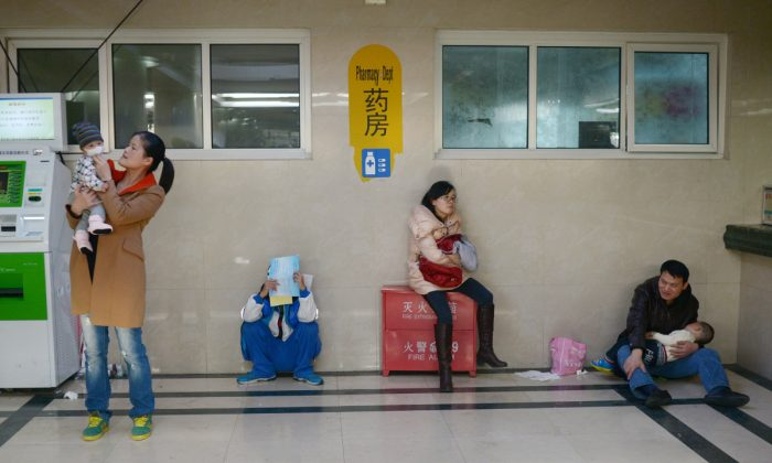 Parents and children at a hospital in China. (Wang Zhao/AFP/Getty Images)
