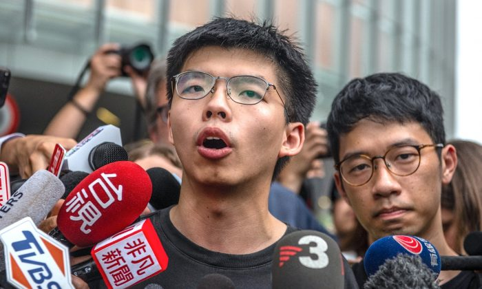 Pro-democracy activist Joshua Wong speaks to the media outside the Legislative Council shortly after being released from prison in Hong Kong, on June 17, 2019. (Carl Court/Getty Images)