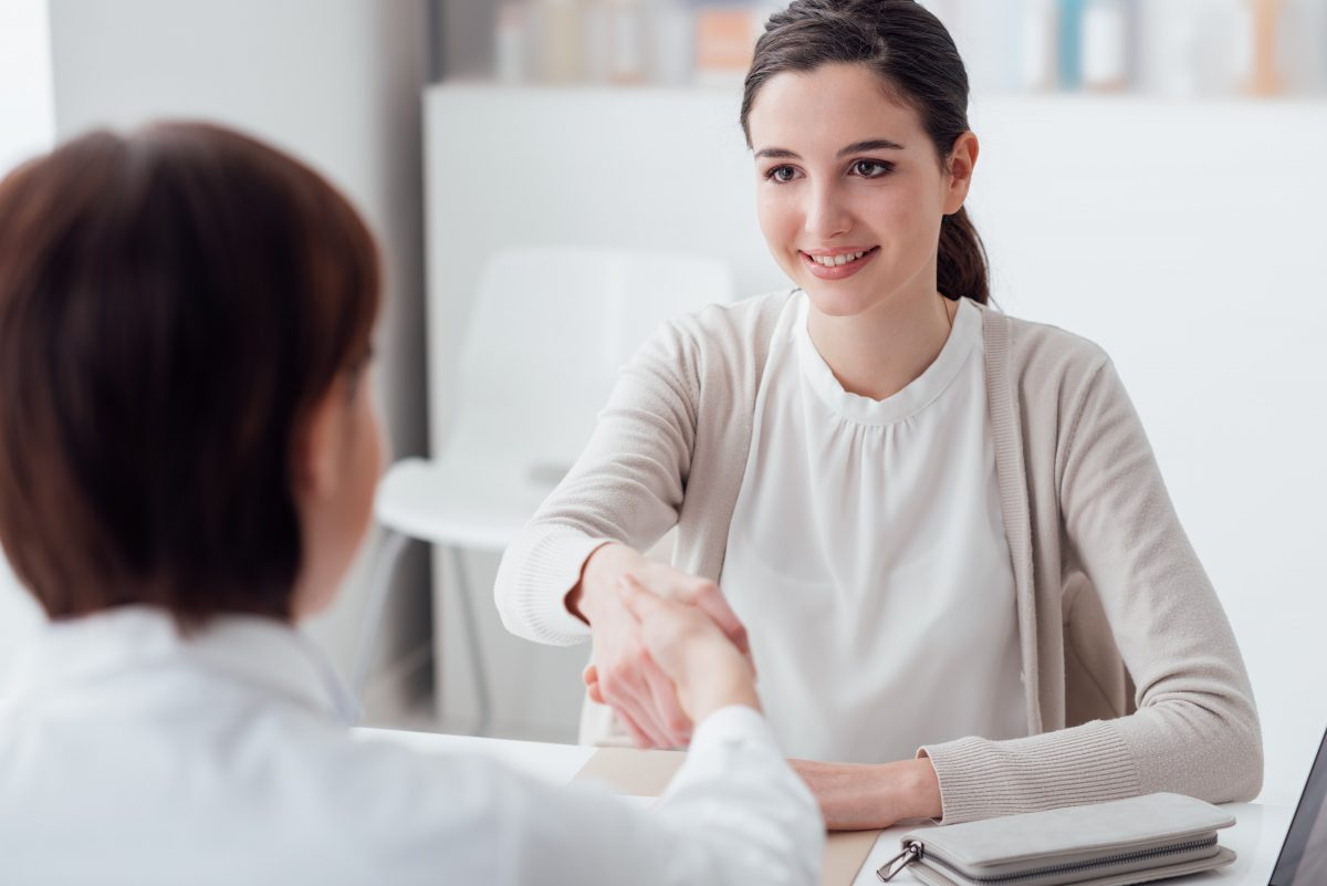 woman shaking hands with doctor