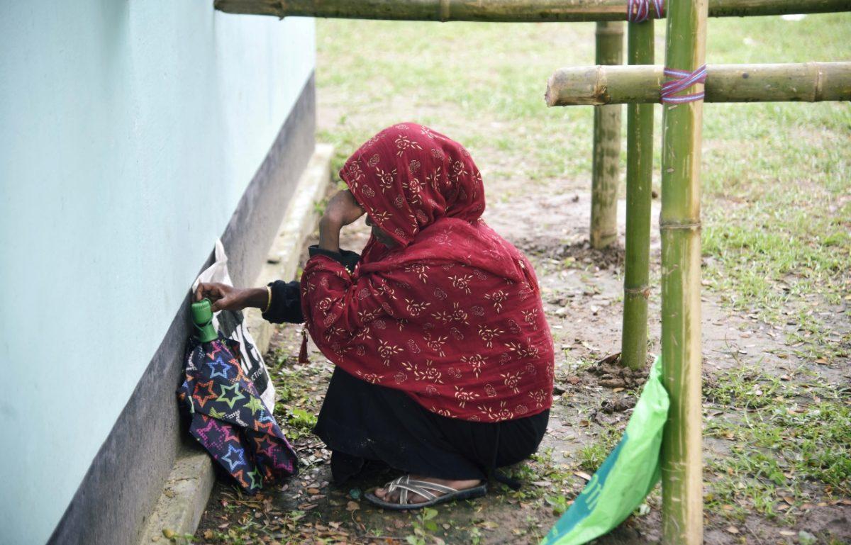 India woman waits to check NRC list