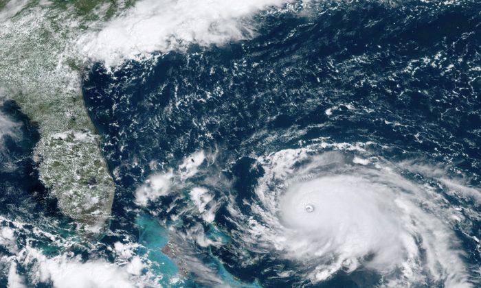 Hurricane Dorian, right, churning over the Atlantic Ocean, on Aug.31,2019.(NOAA via AP)