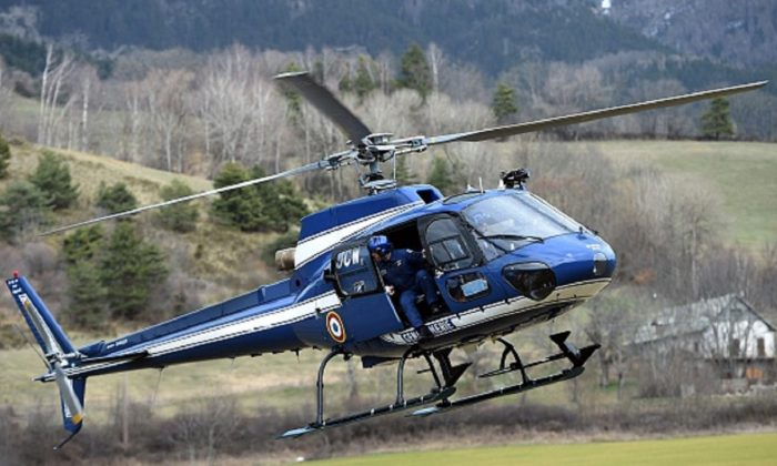 An Aerospatiale AS350 Ecureuil helicopter of the French National Gendarmerie is seen in Seyne, south-eastern France, near the site where a Germanwings Airbus A320 crashed in the French Alps., on March 24, 2015. (Anne-Christine Poujoulat /AFP/Getty Images)