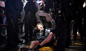 Clashes Between Police and Protesters Grow Violent as Officers Storm Subway, Fire Weapons