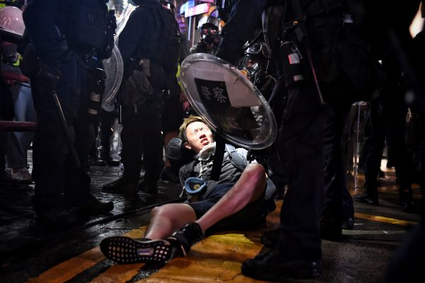 A protester is detained at Causeway Bay in Hong Kong on Aug. 31, 2019. (Lillian Suwanrumpha/AFP/Getty Images)