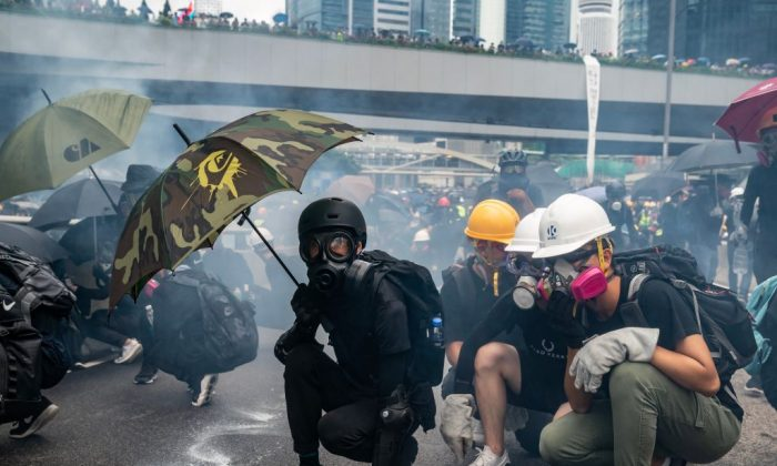Protesters standoff with police in a cloud of tear gas during a clash outside of Central Government Complex in Hong Kong on Aug. 31, 2019. (Anthony Kwan/Getty Images)
