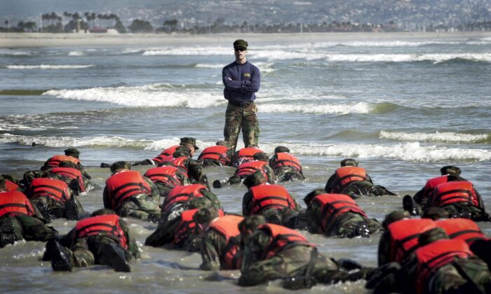 Navy SEAL recruits are pushed to their physical and mental limits during a six-month Basic Underwater Demolition/SEAL (BUD/S) training in Coronado, Calif., in this file photo. (Photographer's Mate 2nd Class Eric S. Logsdon/U.S. Navy via Getty Images)