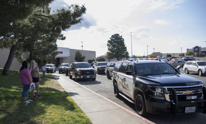 Odessa, Texas police officers park their vehicles outside Music City Mall. (Jacy Lewis/Reporter-Telegram via AP)