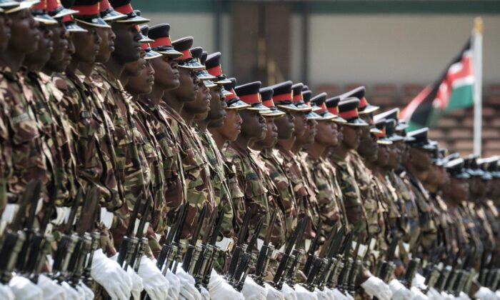 Kenyan army soldiers perform during the rehearsal of the inauguration ceremony of the President at the Moi International Sports Center's Kasarani Stadium in Nairobi on Nov. 27, 2017. (AFP Photo/Yasuyoshi Chiba)