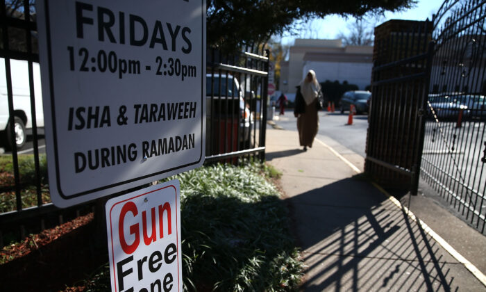 A sign reads Gun Free Zone at the entrance to the Dar Al-Hijrah Mosque, Dec. 4, 2015 in Falls Church, Va. (Mark Wilson/Getty Images)