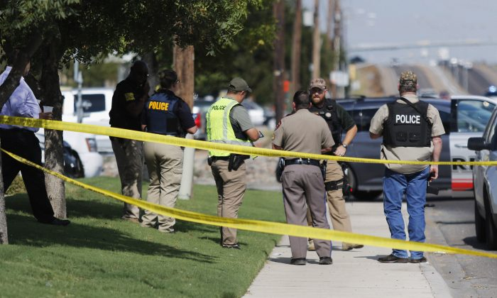 Authorities cordon off a part of the sidewalk in the 5100 block of E. 42nd Street in Odessa, Texas, on Aug. 31, 2019. (Mark Rogers/Odessa American via AP)