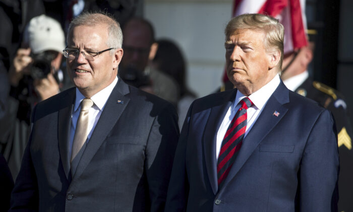 Australian Prime Minister Scott Morrison and President Donald Trump attend an official visit ceremony at the South Lawn at the White House in Washington on Sept. 20, 2019. (Zach Gibson/Getty Images)