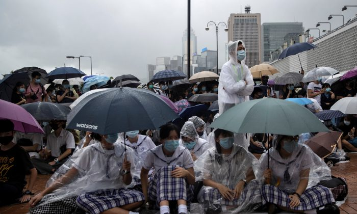 School students boycott their classes as they take part in a protest in Hong Kong, on Sept. 2, 2019. (Danish Siddiqui/Reuters)