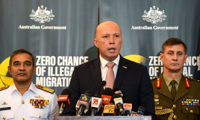Australia's Home Minister Peter Dutton (C) speaks to the media as Sri Lanka's navy commander Piyal De Silva (L), and the head of Australia's Operation Sovereign Borders Major General Craig Furini (R) look on in Colombo on June 4, 2019. (AFP/Getty Images)