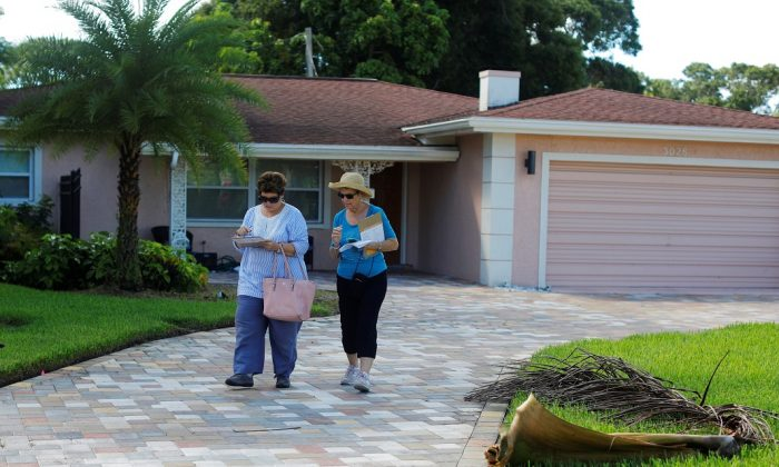 Volunteers Anne Ghosh and Diana Fitser record notes while canvassing door-to-door for the Democratic Party of Pinellas County in St. Petersburg, Florida on Aug. 24, 2019. REUTERS/Brian Snyder