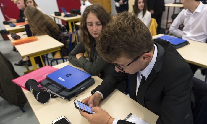 In this photograph taken on Sept. 26, 2017, high school students use smartphones and tablet computers at the vocational school in Bischwiller, eastern France.    Since the beginning of the school year in eastern France some 31,000 high school pupils have replaced their traditional textbooks by computers and tablets, a move popular with students but opinion is divided among teachers and parents. PATRICK HERTZOG/AFP/Getty Images