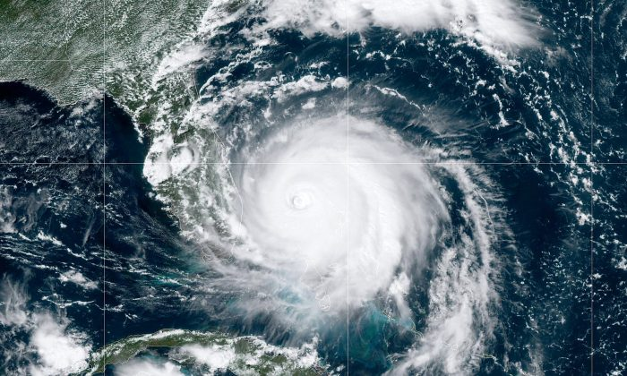 In this NOAA GOES-East satellite handout image, Hurricane Dorian, now a Cat. 4 storm, moves slowly past Grand Bahama Island on Sept. 2, 2019 in the Atlantic Ocean. (NOAA via Getty Images)
