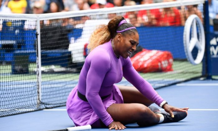 Serena Williams of the USA reacts after a fall at the net during a match against Petra Martic of Croatia in the fourth round on day seven of the 2019 U.S. Open tennis tournament at USTA Billie Jean King National Tennis Center on Sept. 1, 2019. (Robert Deutsch-USA TODAY Sports via Reuters)