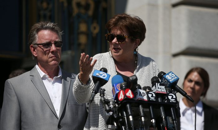 Liz Sullivan and Jim Steinle, the parents of Kate Steinle who was killed by an undocumented immigrant, speak during a news conference in San Francisco on Sept. 1, 2015. (Justin Sullivan/Getty Images)