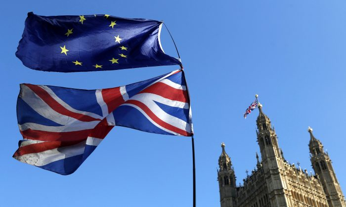 The flag of the European Union and the British national flags are flown on poles during a demonstration by remain in the EU outside spporters the Palace of Westminster in London on Feb. 27, 2019. (Alastair Grant/AP Photo)