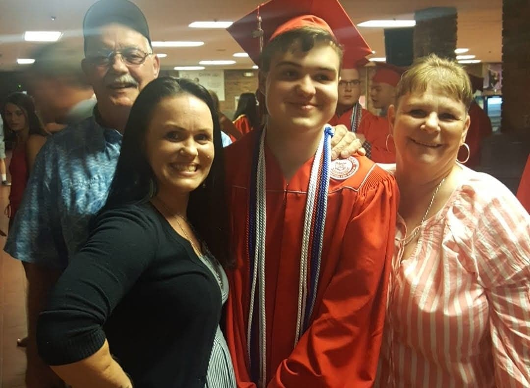 Michael Ardt (2nd R) with his mother Janice (2nd L) and his grandparents during his high school graduation ceremony