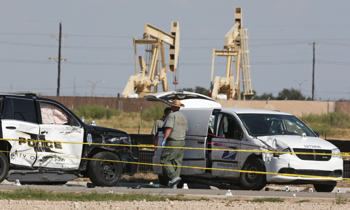 Law enforcement officials process the crime scene on Sept. 1, 2019, in Odessa, Texas, from Saturday's shooting which ended with the alleged shooter being shot dead by police in a stolen mail van, right. (Sue Ogrocki/AP)