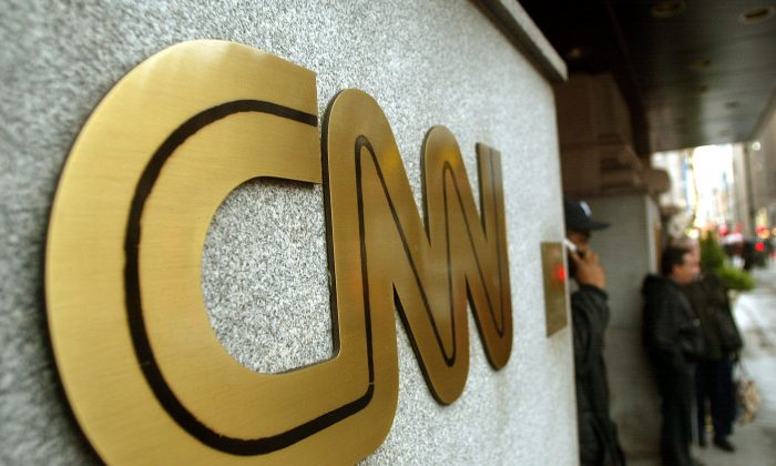 The CNN sign is seen outside its headquarters Nov. 12, 2002 in New York City. (Mario Tama/Getty Images)