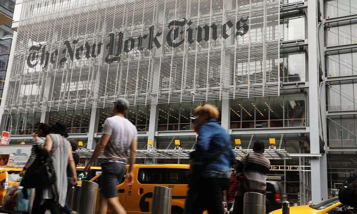 People walk past the New York Times building in New York City in a file photograph. (Spencer Platt/Getty Images)