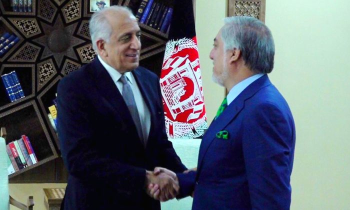U.S. special representative for Afghanistan, Zalmay Khalilzad (L), shakes hands with Afghanistan's Chief Executive Abdullah Abdullah in Kabul, Afghanistan on Sept. 2, 2019. (Afghan Chief Executive office/Handout via Reuters)