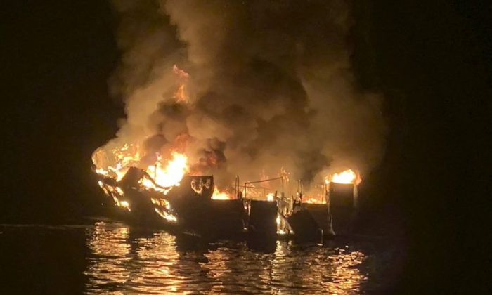 A dive boat is engulfed in flames after a deadly fire broke out aboard the commercial scuba diving vessel off the Southern California Coast on Sept. 2, 2019. (Santa Barbara County Fire Department via AP)