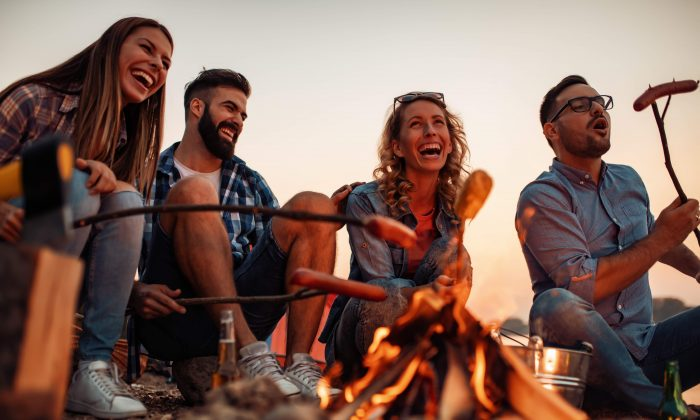 Sharing stories around a fire has a potent power to bond people in a shared experience. (Ivanko80/Shutterstock)