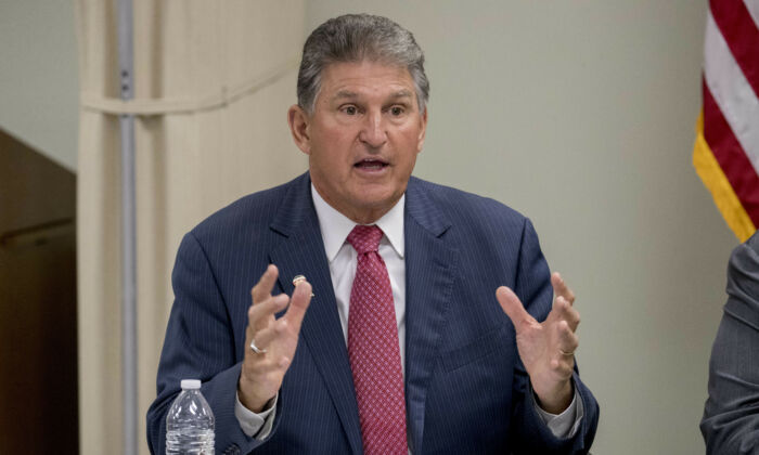 File photo, Sen. Joe Manchin, (D-W.Va.), speaks at a roundtable on the opioid epidemic at Cabell-Huntington Health Center in Huntington, West Virginia, July 8, 2019. (AP Photo/Andrew Harnik, File)
