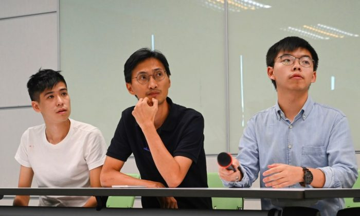 (L-R) Hong Kong pro-democracy activist Lester Shum, Hong Kong lawmaker Eddie Chu, and Secretary-General of Demosistō Joshua Wong attend a press conference at the headquarters of Taiwan's ruling Democratic Progressive Party (DPP) in Taipei on Sept. 3, 2019.  (Sam Yeh/AFP/Getty Images)