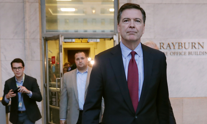 Former Federal Bureau of Investigation Director James Comey leaves the Rayburn House Office Building after testifying to the House Judiciary and Oversight and Government Reform committees on Capitol Hill in Washington on Dec. 7, 2018. (Chip Somodevilla/Getty Images)