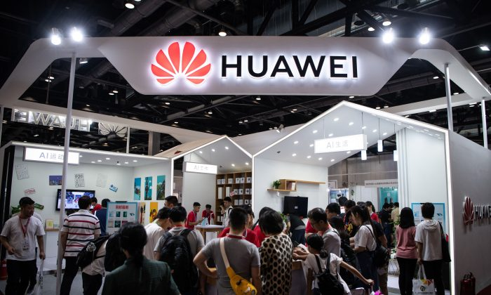 Attendees visit a Huawei exhibition stand during the Consumer Electronics Expo in Beijing, China on Aug. 2, 2019. (Fred Dufour/AFP/Getty Images)