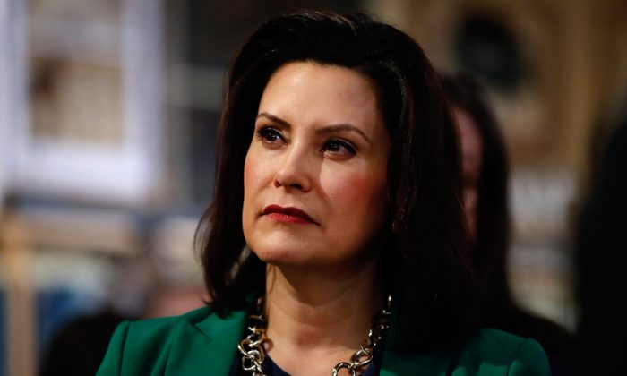 Michigan Gov. Gretchen Whitmer listens to Democratic presidential candidate Sen. Kirsten Gillibrand (D-N.Y.) in Clawson, Mich., on March 18, 2019. (Paul Sancya/AP)