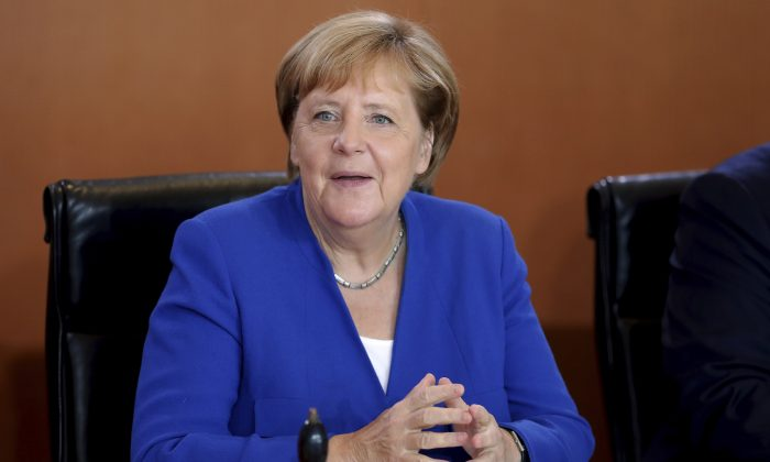 German Chancellor Angela Merkel smiles as she arrives for the weekly cabinet meeting at the Chancellery in Berlin, Germany on Sept. 4, 2019. (Michael Sohn/AP)